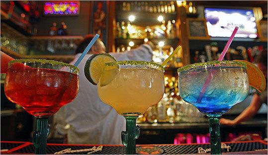 Sunset Cantina owner Mark Kadish works behind the bar -- and three margaritas.