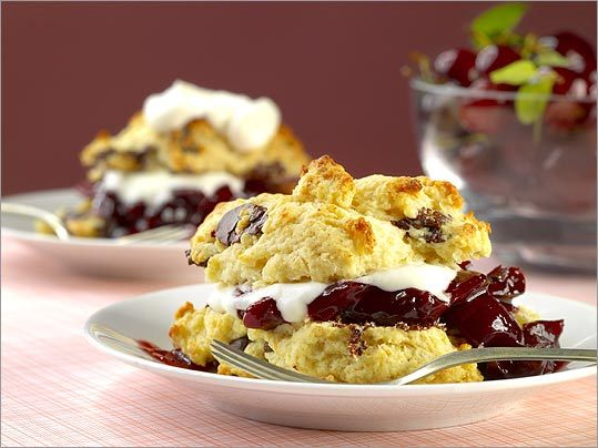 One-two punch Extra large chocolate morsels stud shortcakes that are served with cherry compote and cream inside.