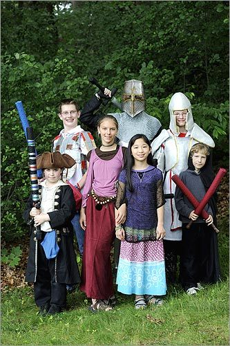 At the Wizards & Warriors day camp in Burlington, taking up foam swords and crossbows against a sea of troublesome villains -- human and otherwise -- is all in a day's work. Clockwise from bottom left: Isaac Bernoff, 10, Joseph Hall, 15, camp staffer Cory Philips, 28, Daniel Honeywell, 12, Oz Breton, 9, Mia Ferraiolo, 12, and Gwen Wilbert, 12, attended the camp.