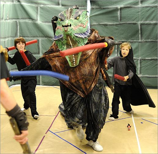 The dragon played by Dan Feldman, 16, battles with the foam swords at Wizards & Warriors camp.