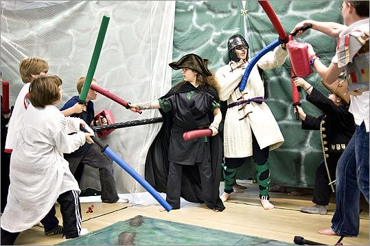 Sarah Breslam, 15, and Matt Alberghini, 17, center, fend off attack during Wizards & Warriors camp.
