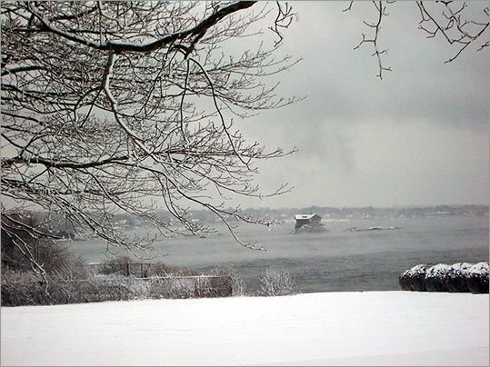 In Wintertime The House On A Rock Stands Out In The Icy Gray Seascape