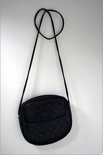 """Gucci purse ($14, church sale on Cape Cod): """"Every time I wear it, I get loads of compliments. It's one of those rare finds that make me giddy."""""""