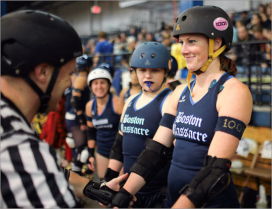 Referee 'Three-Day Bender' performed an equipment check on Boston Massacre's 'Sugar Hits.' Roller derby is an expensive sport, with most of the costs being assumed by the actual players.