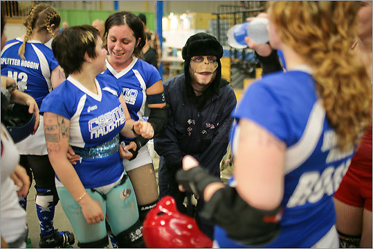 The Cosmonaughties' mascot, Drago Pisimov (center), celebrated their win with team members. For more information about the Boston Derby Dames and for future bout schedules, visit bostonderbydames.com