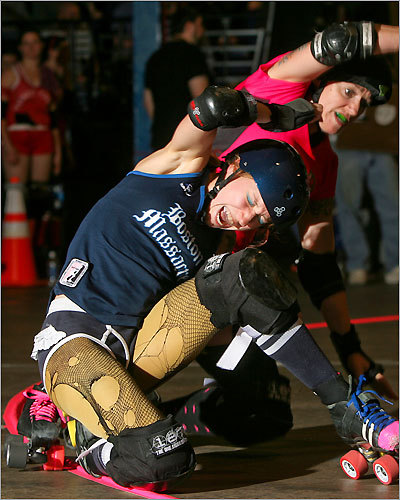 Boston Massacre's 'Pussy Venom' (left) was pushed out of bounds by the Pikes Peak Derby Dames' 'Pepper Slay.'