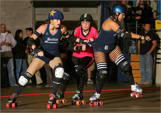 Boston Massacre's 'Sugar Hits' (left) and 'Anna Wrecks' Ya' (right) struggled with the Pikes Peak Derby Dames' 'Count Smacula' (center).
