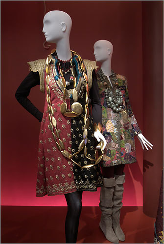 Two ensembles from the fashion collection of Iris Apfel. Tunic, Tunisian wedding garment, early 20th century. Red and black wool gauze with gold paillette, coiled thread, and hammered metal embroidery, green and gold braided piping, and blue silk and metalic filé trapunto. Necklaces, Givenchy, 1970s. Black, red, and gray silk passementerie with rhinestones. Necklaces and bracelet, Monies, c. 2003. Gilded wood. Jacket, Oscar de la Renta, circa 2000. Multicolored patchwork of silk faille, silk damask, and cotton velvet with multicolored silk and gold filé thread and gold metal paillette embroidery. Necklaces, Angela Caputi Giugiù, circa 2001. Acrylic and metal. Boots, Kenzo, circa 1990. Taupe suede.