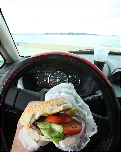 Eating a hamburger while driving can be dangerous