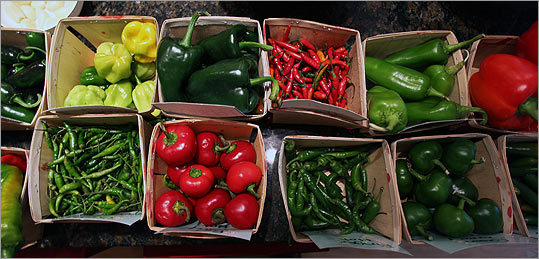 The crop includes several varieties of peppers, ready for pickling and roasting.