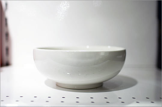 For bibimbap or noodle dishes, there are deep, white ceramic bowls with a contemporary look.