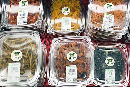 Over 100 varieties of side dishes are packed into the banchan corner , including all kinds of kimchi. Pick a spicy cucumber, hot-sweet crunchy baby crabs, and a vinegary daikon pickle.