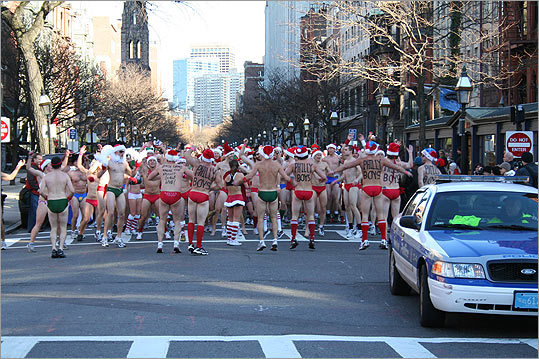 After rounding Berkeley Street and making their way down Newbury Street, the runners stopped to get the blood pumping with a round of group jumping jacks.