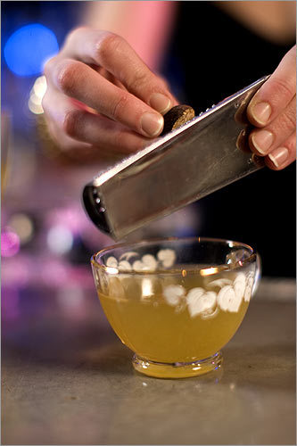 Silent Night Punch , a variation on an 18th-century punch recipe Serves about 40 people 2 green tea bags 8 lemons 1&#190; cups superfine sugar 1 liter Pierre Ferrand Ambre cognac 1 375 ml. bottle Plantation fiver-year-old rum> 6 oz. Green Chartreuse 6 oz. Benedictine 1. Two days before the party, fill a small metal bowl (sized to scale with the punch bowl) with water and stash it in the freezer. 2. A few hours before or the night before the party, steep two green tea bags in two cups water for 5 minutes. Set aside to cool. Peel 8 lemons. In a large bowl, muddle peels in sugar until oil is absorbed. Add tea, cognac, dark rum, Green Chartreuse, and Benedictine to the bowl. Stir until sugar is dissolved. Add four cups of cold water and refrigerate. 3. Just before serving, add 12 oz. fresh-squeezed lemon juice to the alcohol-sugar-tea mixture. Pop the ice from the metal bowl and add it to the punch bowl. Serve it in punch glasses with a little fresh nutmeg grated over the top.