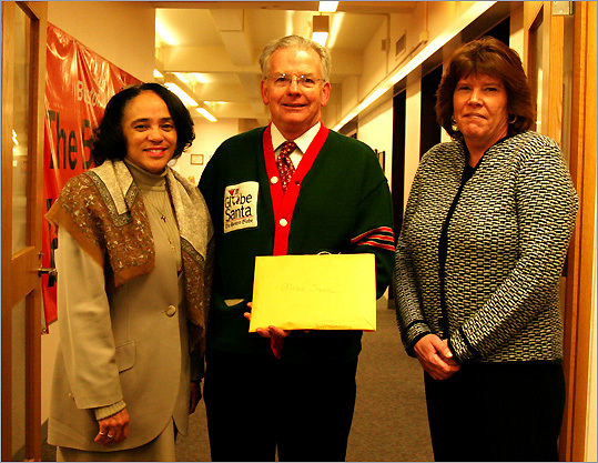 Dec. 22 in Boston From left: Boston School Superintendent Carol R. Johnson, Globe Santa director William F. Connolly Jr., Carolyn Hajjar, staff assistant at the Boston public schools office on 26 Court St. Connolly holds a donation from the schools of $13,856.53. Learn more Make a donation