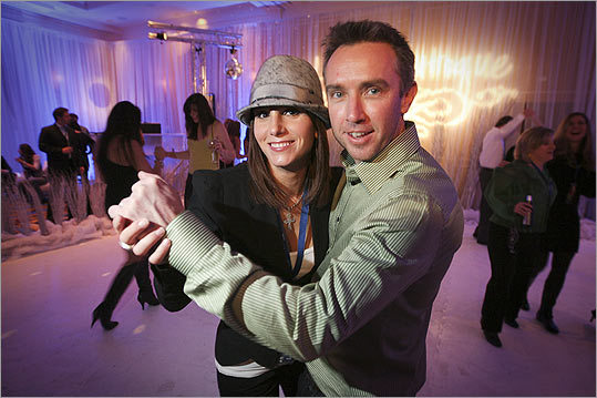 Tiffany Ortiz, wife of Red Sox slugger David Ortiz, and 'The Company Men' actor Lance Greene dance during the Winter Classic pre-party held at Hotel Commonwealth in Boston on December 30.