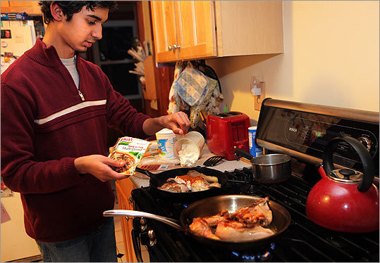 Mubashir Ghani Khawaja, 15, cooks dinner twice a week for his Maynard host family.