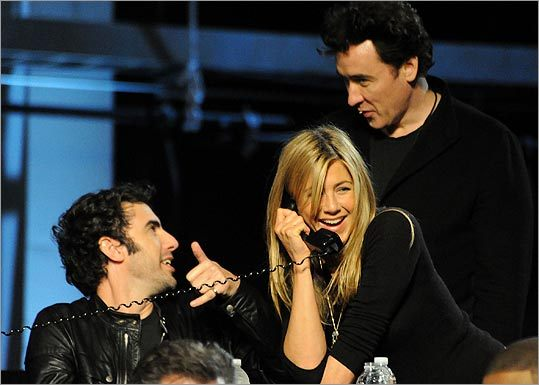 Sacha Baron Cohen, Jennifer Aniston, and John Cusack