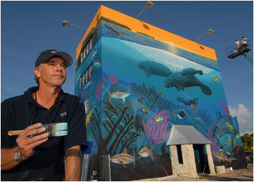 Dive into the Keys WYLAND, artist ''What should you do here? Come learn to be a diver,'' says diver par excellence Wyland, who shares what he sees underwater in his art. As you approach Key Largo on the Overseas Highway, a scene of manatees and bottlenose dolphins grabs your eye, one of over 100 ''whaling walls'' he's painted around the world. ''I've had the Keys disease since high school,'' says the artist, who spends most of his Keys time underwater in the Florida Keys National Marine Sanctuary ( floridakeys.noaa.gov ). ''I've been diving the world's oceans for 25 years and this is some of the best.'' Wyland recommends Islamorada's Ziggie & Mad Dog's, ''The best rib eye you ever had'' ( www.ziggieandmaddogs.com ). Key lime pie? ''Snapper's. Tell them I sent you'' ( www.snapperskeylargo.com ).