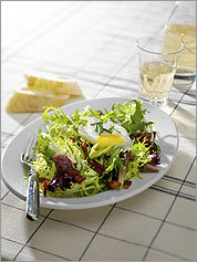 Nice bite A dressing that's sharper than the usual vinaigrette helps balance the rich bacon and egg that make this salad a meal.