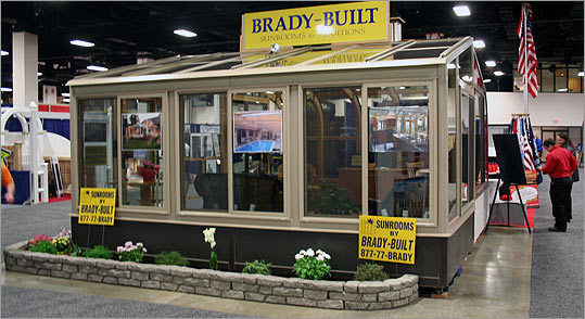 If you're thinking summer, a sunroom might be in order. This display by Brady-Built Sunrooms lets in plenty of light and gives your house a more spacious feel.