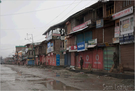 The town of Magam, usually a bustling market with shops spilling goods out onto the street, was in the midst of a curfew after violence between two groups erupted last week.