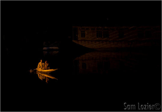 A lone shikara crossing Dal Lake.