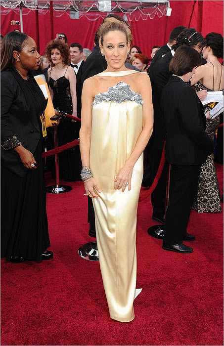 """Sarah Jessica Parker made the potentially risky move of channeling """"Funny Girl''-era Barbra Streisand with a 1968 coiffure and lengthy lashes that would be the envy of Twiggy. But her butter cream Chanel silk dress kept the ensemble from turning into a Raquel Welch """"Myra Breckinridge'' costume. The dress will surely polarize fashion followers, but at least Parker was brave enough to step away from vampish gowns that often clog the red carpet."""