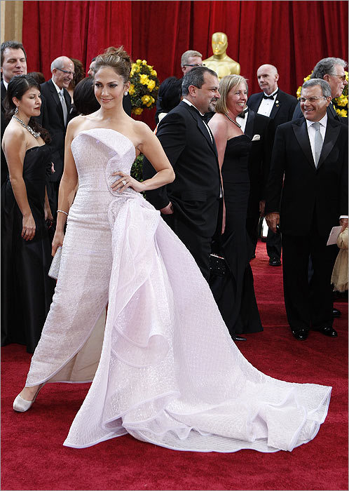 If Jennifer Lopez had as much skill at choosing music and film parts as she does choosing red carpet gowns, her career would be in a much better place. Her stunning Armani Privé dress was a shimmering sea of barely-there pink, with layers of fabric cascading from her hip. Pink is always dangerous, but her whisper-quiet shade was subtle, and the design sublime.