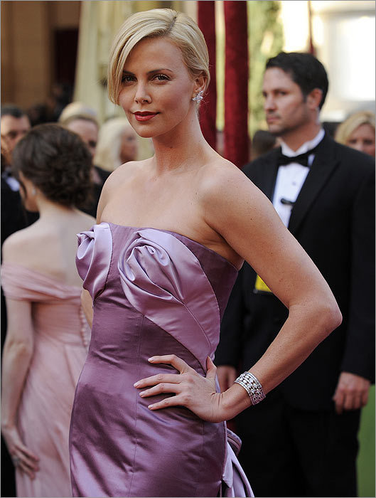 Not so precious... Charlize Theron In theory, Theron in Dior Couture should be the stuff of glitzy dreams. But the roses on her bosoms make her look like a cheap burlesque dancer rather than an Oscar presenter.