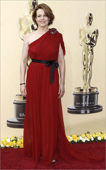 Not so precious... Sigourney Weaver Was there a pact that all ''Avatar'' actresses would dress poorly? Sigourney, put this red drape back in your window and go shopping for a decent Oscar dress.