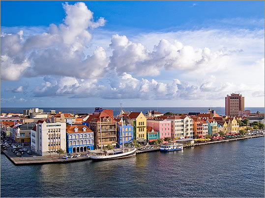 Curacao When it comes to culture, this neighboring island can top Aruba any time of the year. Stroll along the narrow streets of the capital, Willemstad, and you'll see exquisite 17th- and 18th-century Dutch Colonial buildings rarely found outside the Netherlands. [cont. on next page]