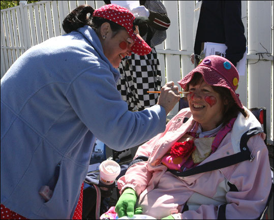 Goreti LeVasseur and Jan Rupert of East Providence, R.I. are members of the Caring Clown Ministry of the United Methodist Elder Care Center. Suiting up as clowns 'Pippy' and 'Jazzy,' they're here to cheer for Jan's daughter Keli Rupert, who is running her first marathon.