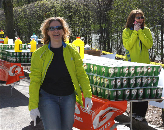 Ann Everett of Whitman and Joanne Colello of Norwell prep to hydrate the runners. They've both been volunteering with the Calvary Chapel and Messiah Miler Running Club for 11 years, since the club starting providing this water station. Each women has run the Boston Marathon three times.