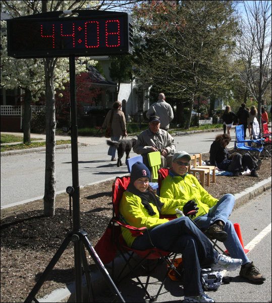 Christine Ahlgren and Bruce Daley of Natick wait for the wheelchair runners to hit the Hill. Bruce has been volunteering with the Greater Framingham Running Club for the past nine marathons. This is Christine's first year.