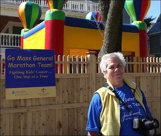 Mimi Katz of Brookline volunteers as a photographer for Massachusetts General Hospital's marathon team.
