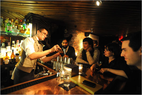 Bartender John deBary shows a homemade chocolate syrup he made as he prepares drinks for Mayur Subbarao, Bryan Zupon, Jessica Kramer and Ross Goldberg at PDT in Manhattan.