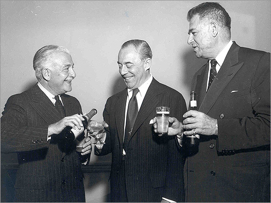 Here's conductor Arthur Fiedler raising a glass with the legendary Richard Rodgers and Oscar Hammerstein.