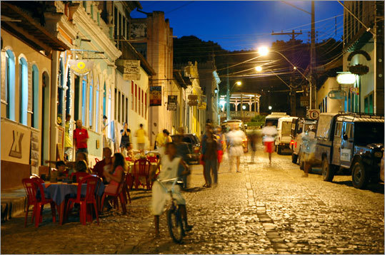 Lençóis, a picturesque town in the heart of Brazil's northeastern state of Bahia. Lençóis's cobbled streets are lined with quaint, one-story miners' cottages, painted in shades of mustard, peach, and lime, the vibrant colors undampened by the moss that clings to every wall.