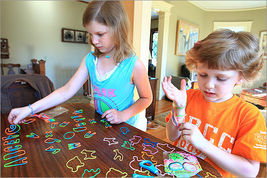 Lillian and Harry McIntyre spread their silly bands out on a table at their home in Roslindale.