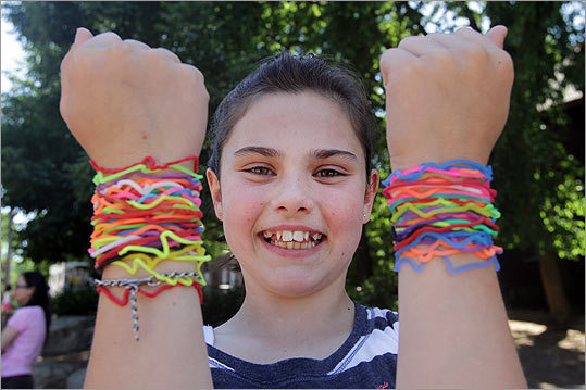 """I really don't know why I like them,'' said Casey McNamara, 10, shrugging cheerfully as she chatted with other girls who were similarly decked out. ""I figured other people liked them.''"
