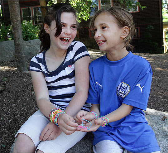 Casey McNamara (left) and her friend Maddie Nagler wear their colorful assortment of silly bands.