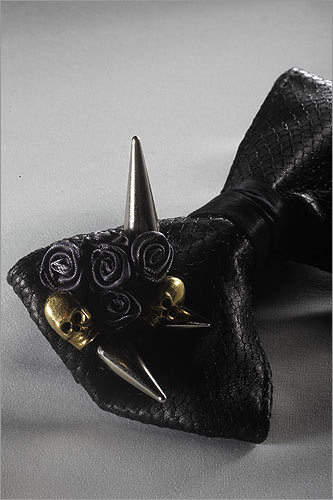 A close-up of the Phantom tie shows off its adornments of spikes and brass skulls.