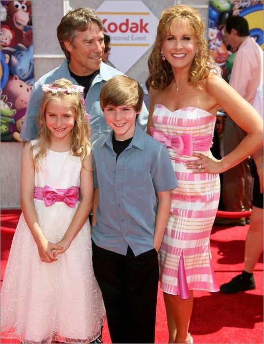 Actress Jodie Benson, who lent her voice to the character Ariel in 'The Little Mermaid' more than two decades ago, was the featured voice of the new character Barbie in the film. Benson is pictured with husband Ray, son McKinley and daughter Delaney.
