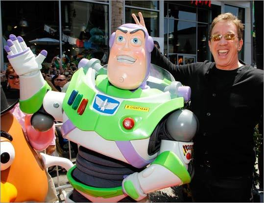 Tim Allen playfully adds some bunny ears to his pal Buzz, whose voice he represents in the 'Toy Story' series.