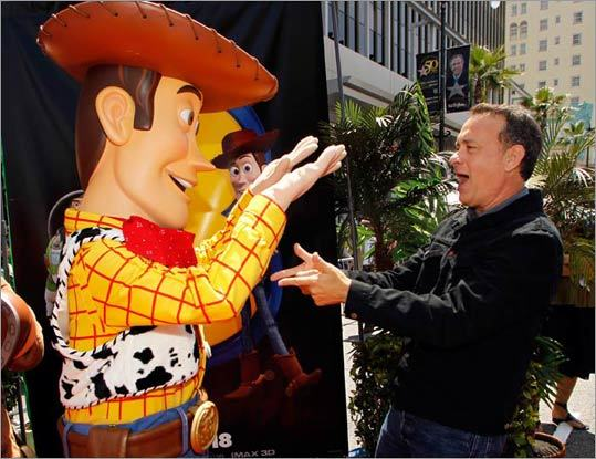 Taking a cue from co-star Tim Allen, Tom Hanks kids around with Woody, whose voice he represents in the film. As Woody would say, 'reach for the sky!'