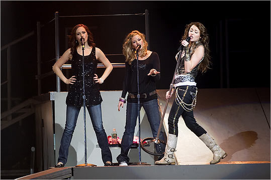 In December 2007, Cyrus brought her traveling show, 'The Best of Both Worlds Tour,' to the Hartford Civic Center, along with backup singers Candice Accola (left) and Dorchester's Kay Hanley. Tickets for the shows sold out in mere minutes, as the tour grossed an estimated $55 million.
