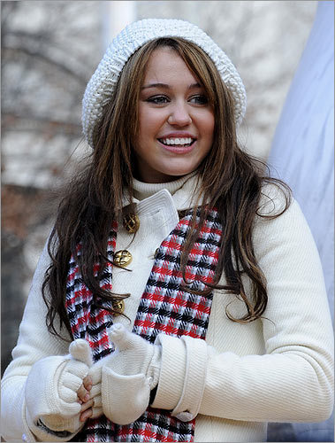 Miley Cyrus rode a float before the start of the 82d annual Macy's Thanksgiving Day parade on Nov. 27, 2008, in New York. Seven months earlier, her public image began changing after an Annie Leibovitz photograph of her bare back ran in Vanity Fair. Around the same time, racy photos of her appeared on the Internet, after her e-mail account was hacked.