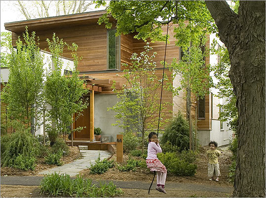 BLENDING IN The Northampton home's exterior, made of cedar and concrete, was designed to recede into the surroundings.