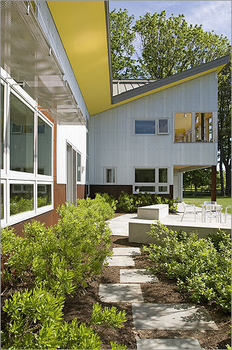 To the architect who designed this LEED Gold-certified home in Falmouth, Maine, it suggests the shape and movement of birds.